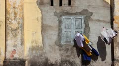 French Colonial: MS clothes blowing next to French colonial building in Asia Stock Footage
