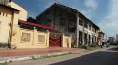 French Colonial: WS pan to old French colonial building in Asia with clothes Stock Footage