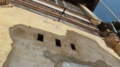 French Colonial: Low angle tilt down French colonial building to drying clothes Stock Footage