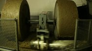 Stone mill crushing olives to produce extra virgin olive oil Stock Footage