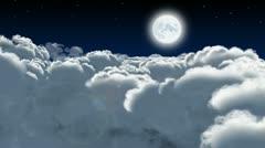 Night flight through cumulus clouds Stock Footage