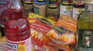 Ethnic food groceries on a market stall Stock Footage