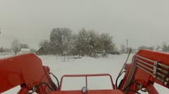 Tractor orange in snow storm P HD 0002 Stock Footage
