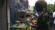 Stock Video Footage of Caribbean man prepares a coconut at a market stall