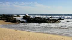 Waves crash onto the rocky coast of Mexico - stock footage