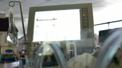 Baby hooked up to heart monitor in hospital Stock Footage
