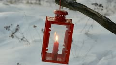 Red lamp with candle in winter garden Stock Footage