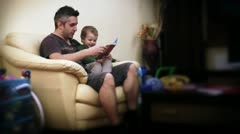 Father and Baby Boy Reading Stories Stock Footage