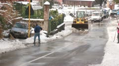Snowplough works after heavy snow in city Stock Footage