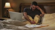 Caucasian Male Working In Bed Day Happy Stock Footage