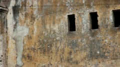 French Colonial: CU pan across textured wall of old French colonial building - stock footage