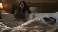 Caucasian Female Working In Bed Night Upset Stock Footage