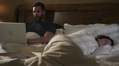 Caucasian Male Working In Bed Night Pillow Fight Stock Footage