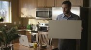 Caucasian Male In Kitchen Sign Happy Stock Footage