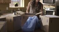 Caucasian Female Packing In Kitchen Stock Footage
