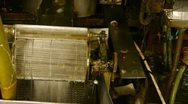 Stock Video Footage of Reeling machine and Textile machine in operation.