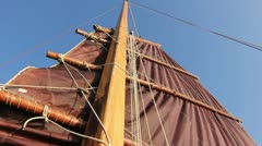 Sails being raised on Junk ship Stock Footage