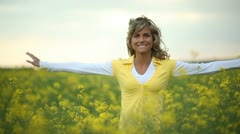 Beautiful woman playing in a rape field; Full HD Photo JPEG - stock footage