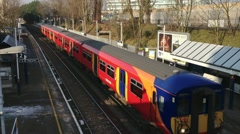 Train arriving at the station Stock Footage