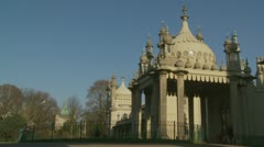 Brighton's Royal Pavilion (ten) skate boarder - stock footage