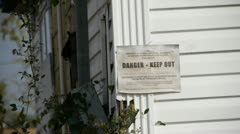 Danger keep out Sign on a home damaged by a Tornado in Birmingham, Alabama Stock Footage