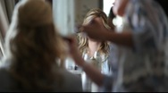 Stock Video Footage of Young Woman Getting Hair and Makeup Done by Stylist