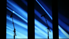 Silhouettes of Microphones with Blue Background - stock footage