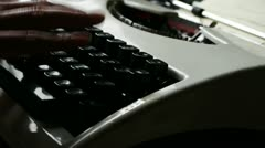 Hands typing on a typewriter. - stock footage