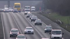 Busy traffic on the M40. Time lapse, extreme long lens Stock Footage