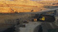 Timelapse. Excavator loading huge dump trucks Stock Footage