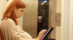 Girl in pregnant in the firm with tablet Stock Footage