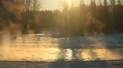 Mist rising off river in winter. - stock footage