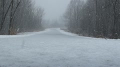 Close up of bicycle trail and falling snow Stock Footage