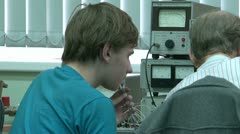 Post-graduate student at the computer in the lab Stock Footage