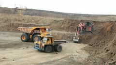 Excavator loading huge dump trucks Stock Footage