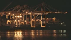Port of Oakland Gantry Cranes at Night 2 Stock Footage