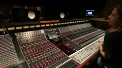 Big recording console with engineer mixing Stock Footage
