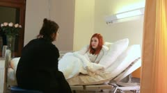 Visiting friends in hospital Stock Footage
