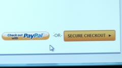 """Secure Chechout"", ""Check out with PayPal"" buttons. Internet Shopping. Stock Footage"