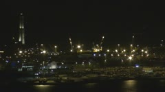 Aerial view of La Lanterna by night, Genoa, Italy Stock Footage