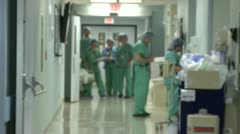 Stock Video Footage of Surgical team wheels patient to operating room