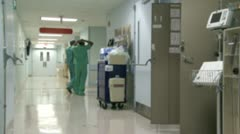 Hospital staff moving through hallway (3 of 3) Stock Footage