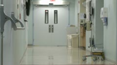 Stock Video Footage of Hospital staff moving through hallway (1 of 3)