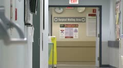Stock Video Footage of Doors close on surgical waiting area