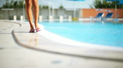 Woman entering into swimming-pool; Full HD Photo JPEG - stock footage