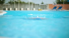 Young swimmer in breaststroke; Full HD Photo JPEG Stock Footage
