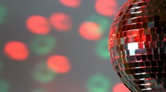 Half mirror ball; green and red light - stock footage
