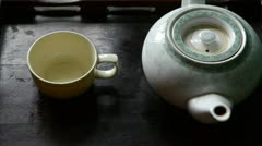 Teapot pouring tea,ancient customs of leisure.china,japan,water. Stock Footage