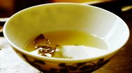 Teapot pouring tea,ancient customs of leisure.china,japan,water,steaming. Stock Footage