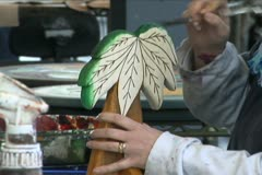 Artist Painting Wooden Palm Tree - stock footage